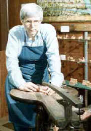 Patricia Walter cutting on an antique scroll saw