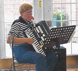 Pat playing accordion